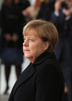 Two years after opening Germany's doors to refugees, Angela Merkel stands tall. How has she done it?
